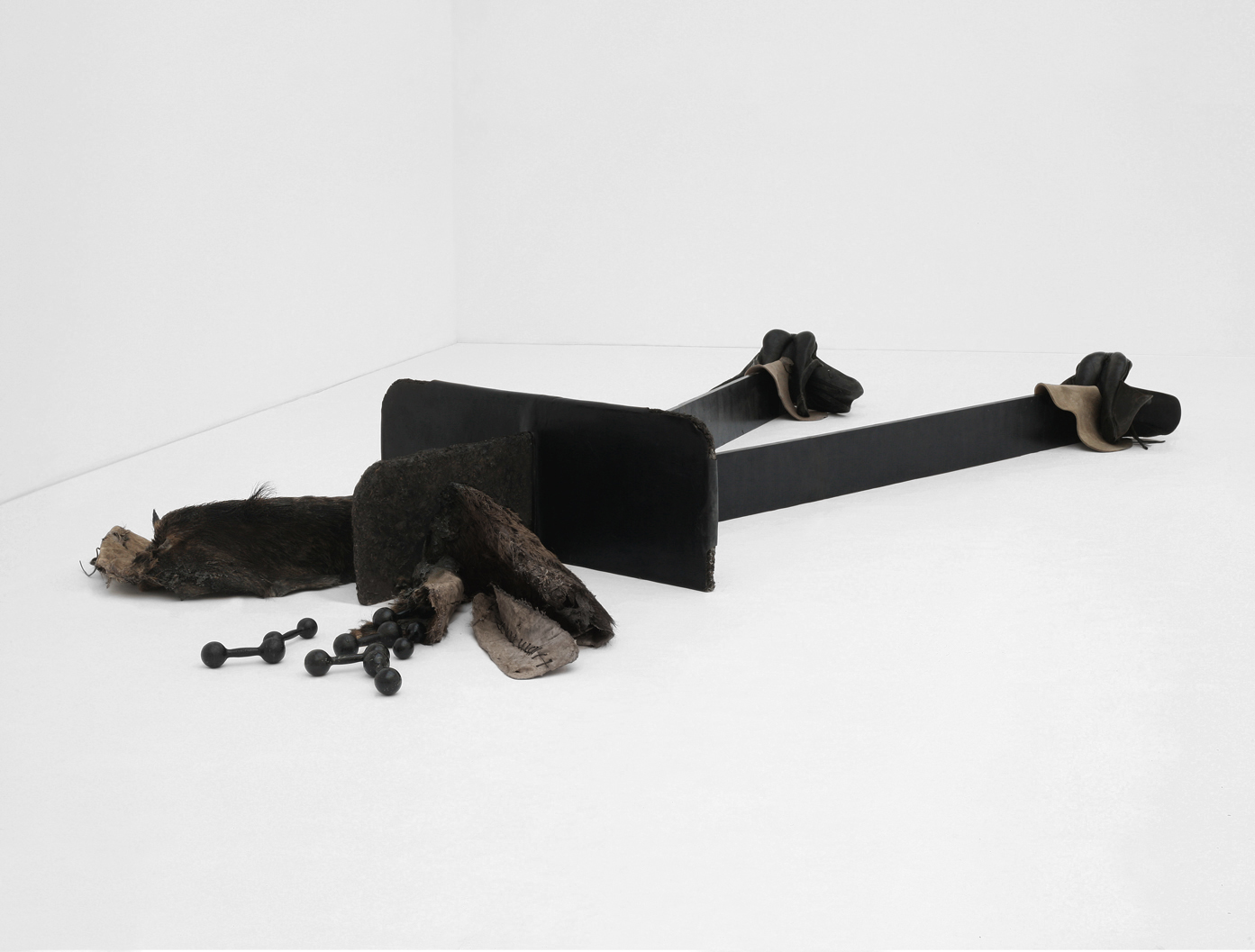 POSSESIA / Schism / 2010 / 700 x 250 x 70 cm /  fur, soil, steel, leather, weights, resin, wood, tar, saddles